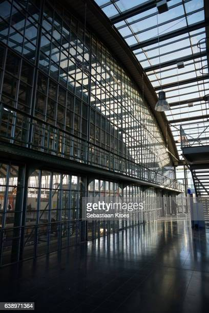 glass façade of the darmstadt central station, germany - darmstadt stock-fotos und bilder