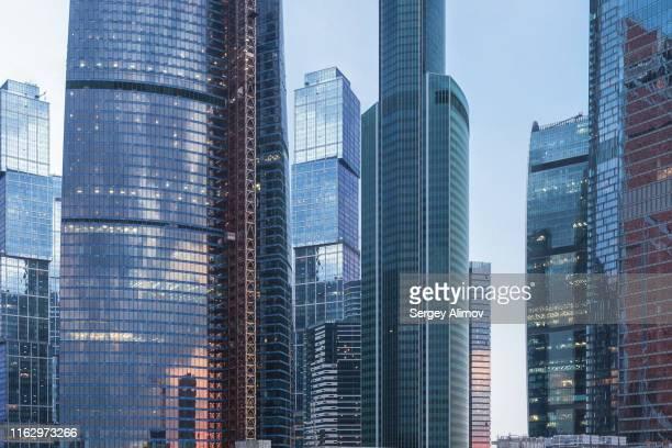 glass facades of the moscow international business center futuristic skyscrapers - moscow bildbanksfoton och bilder