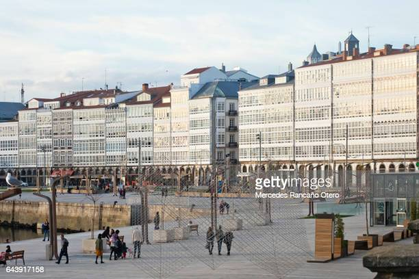 glass facades, waterfront galerias at dusk in la coruña, spain - a coruña stock pictures, royalty-free photos & images