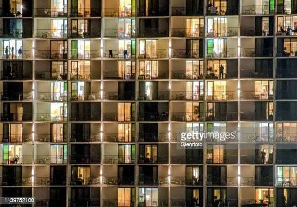 glass fronted building facade in evening - building story stock pictures, royalty-free photos & images