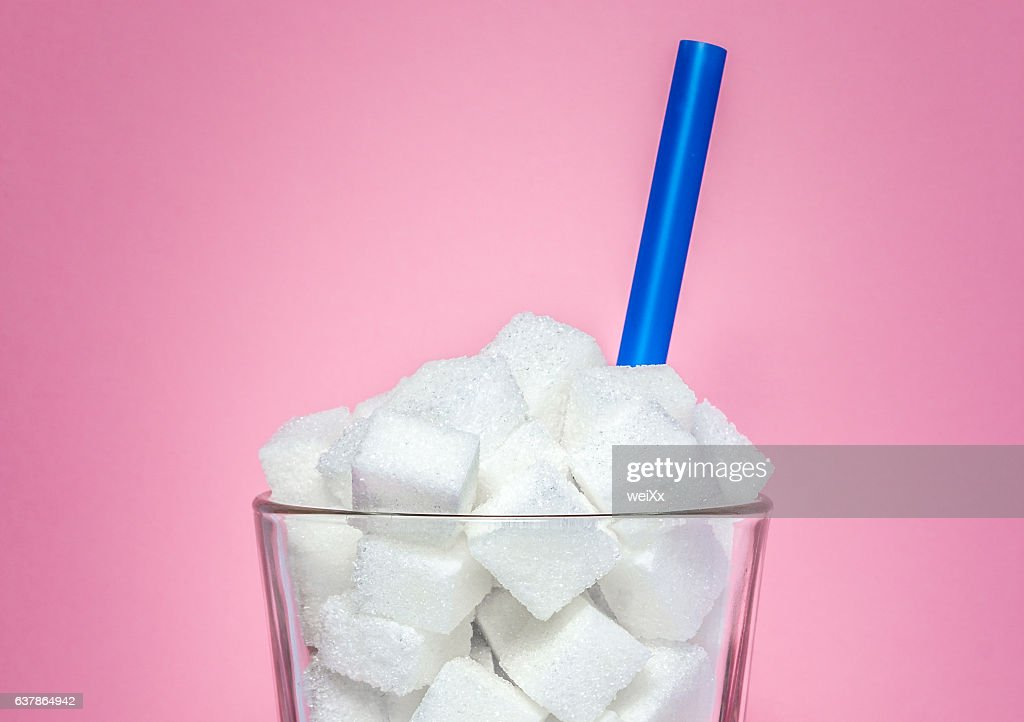 Glass full of sugar cubes - unhealthy diet concept. : Stock Photo