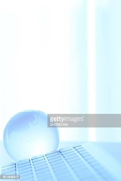 Glass globe and computer