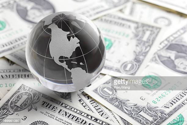 glass globe and money