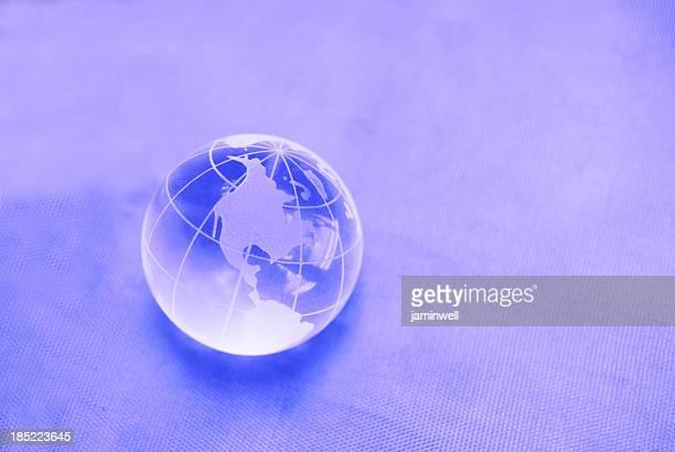 glass globe on purple background