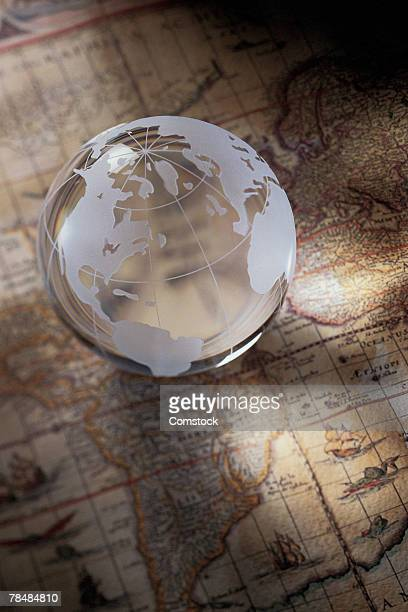 Glass globe on top of map