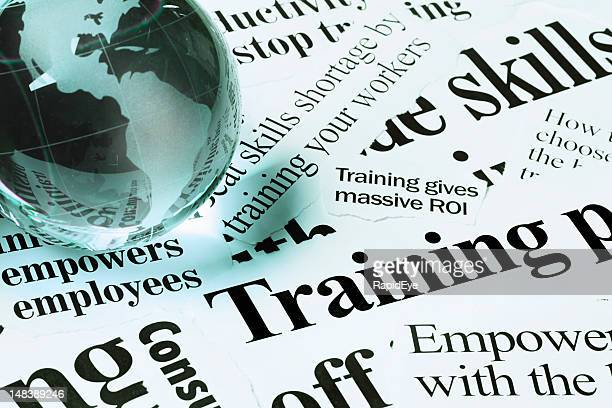 glass globe paperweight on headlines concerning skills & training - western script stock pictures, royalty-free photos & images