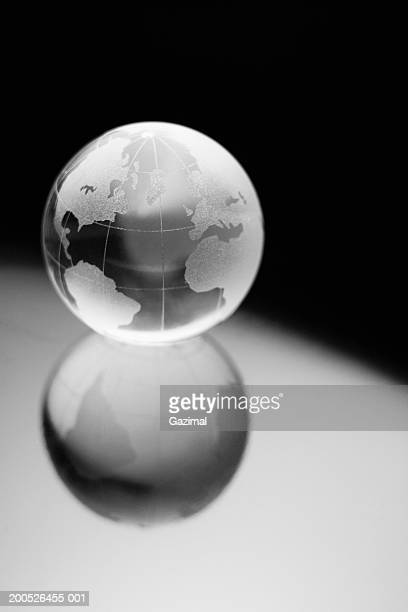 Glass globe reflected on surface