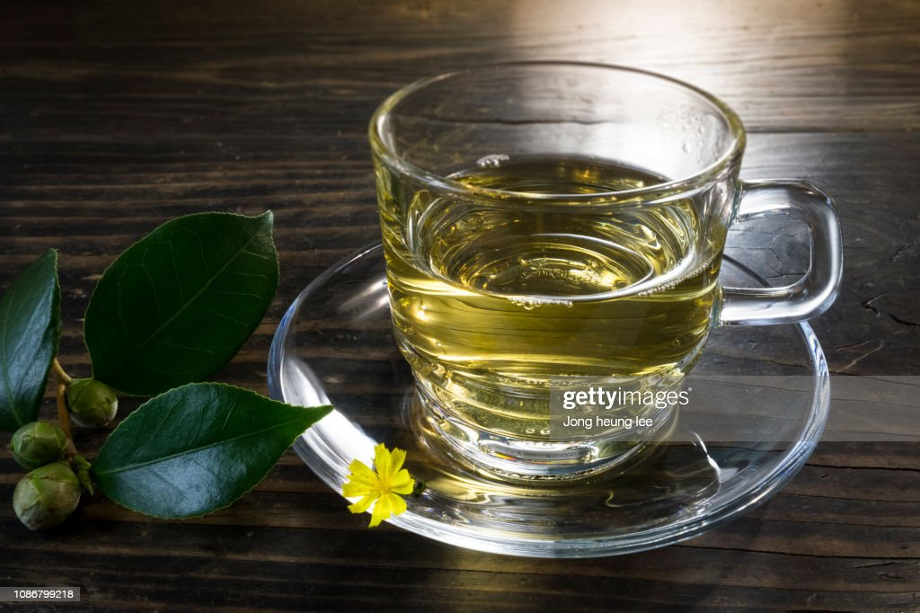 Glass green tea cup set on old table top : Stock Photo