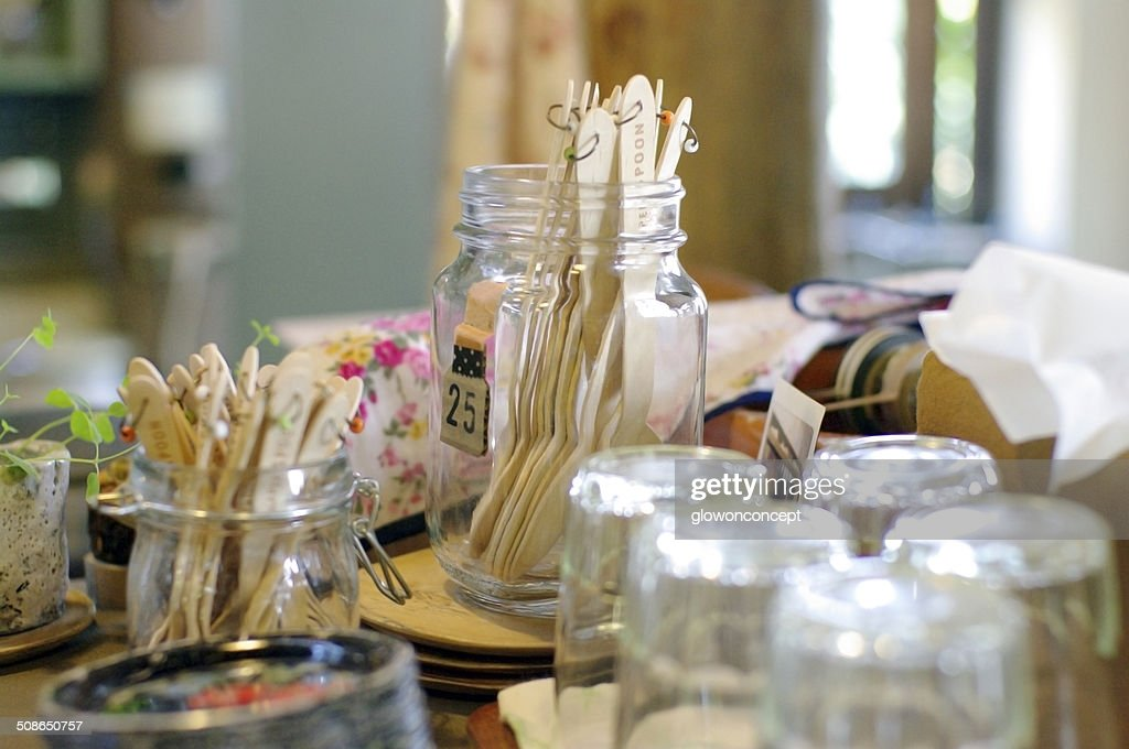 glass jar and cup on coffee shop counter : Stock Photo