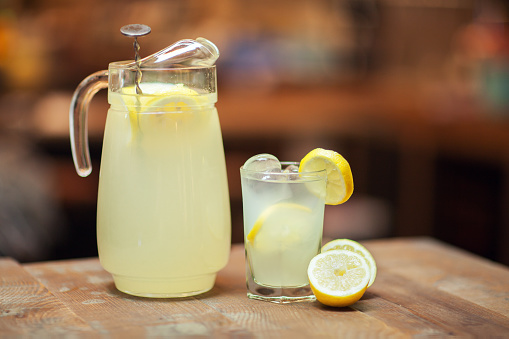 Glass jar and glass with fresh lemonade - gettyimageskorea