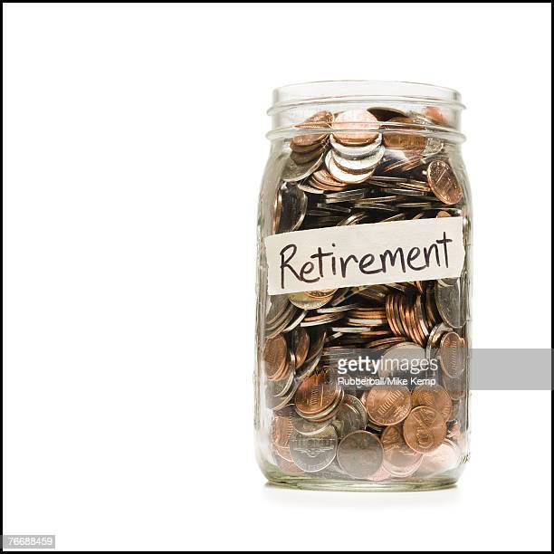 Glass jar with change and Retirement label