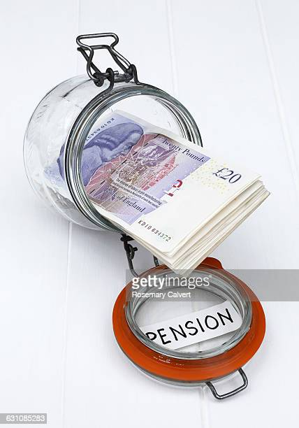Glass jar with twenty pound notes labelled pension