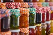 Glass jars of homemade jam and marmalade for sale