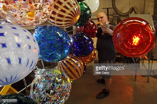 Glass maker and blower Will Shakspeare makes glass baubles in his workshop at Shakspeare Glass and Gallery on December 10, 2010 in Taunton, England....