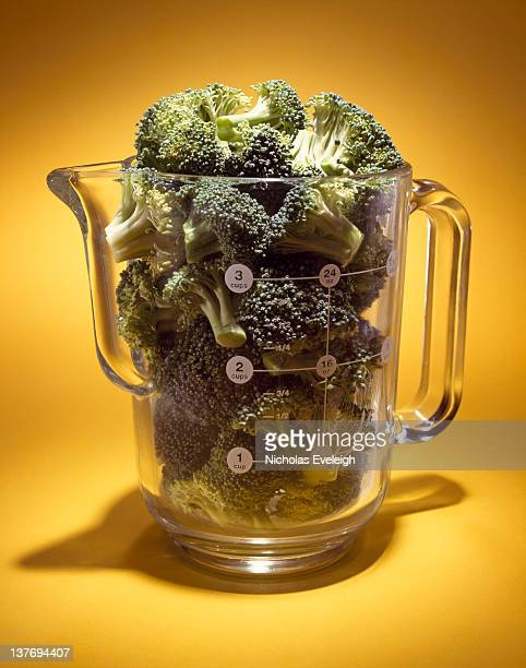 Glass measuring cup with broccoli