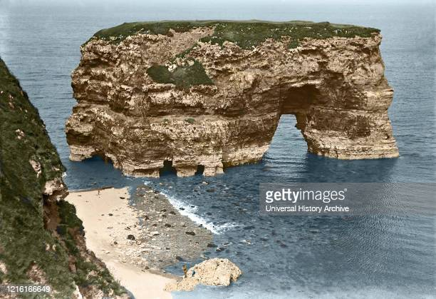 Glass negative circa 1900 Victorian era Marsden rock sea stack in Marsden Bay showing remains of steps to top hand coloured photograph South Shields...