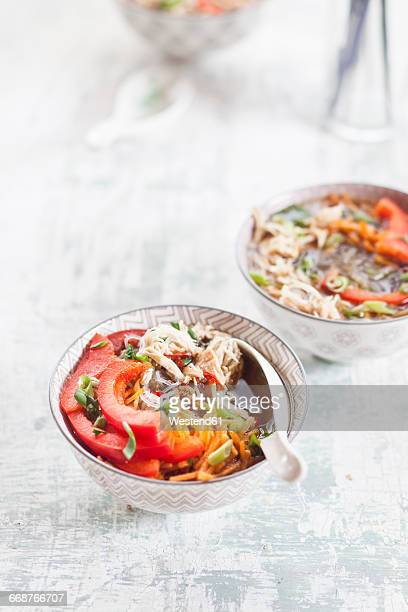 Glass noodle salad in bowl, vegetables and pulled chicken