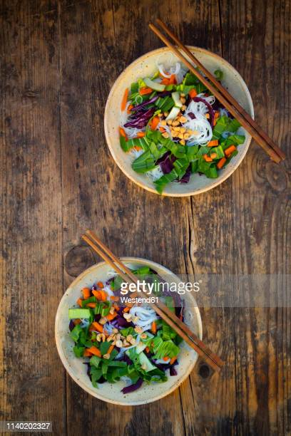 Glass noodle salad  with pak choi, carrot, red cabbage and peanuts, from above