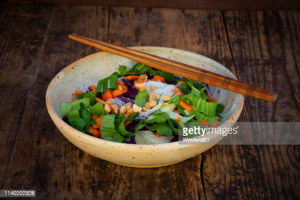Glass noodle salad  with pak choi, carrot, red cabbage and peanuts