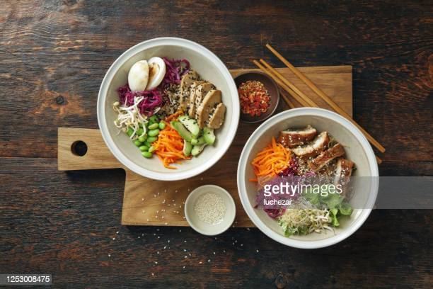 glass noodle stir-fry with eel and vegan poke bowl - meat substitute stock pictures, royalty-free photos & images