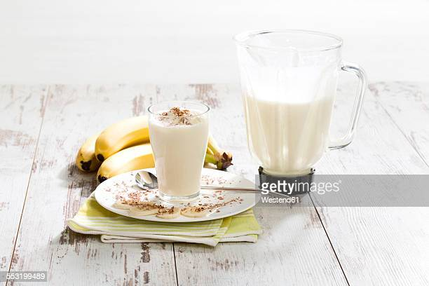 Glass of banana milkshake with whipped cream and chocolate granules