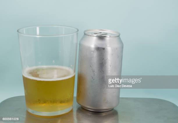 Glass of beer and tin