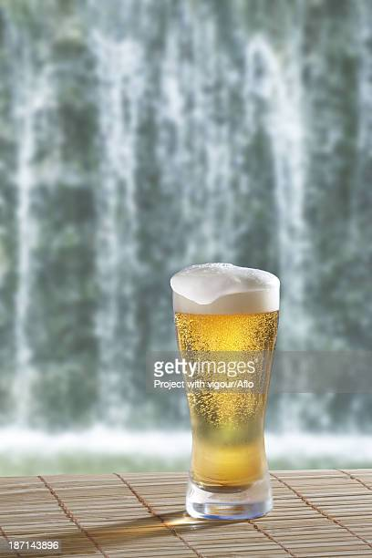 Glass of beer and waterfall