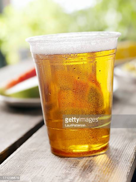 glass of beer at a picnic - disposable cup stock pictures, royalty-free photos & images