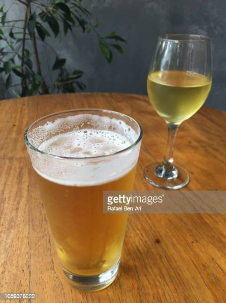 glass of beer beside a glass of white wine - rafael ben ari fotografías e imágenes de stock