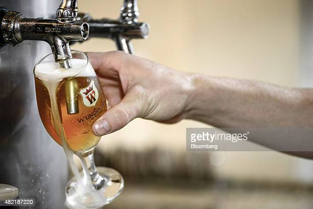 A glass of beer is poured at the Wunder Bier brewery in Blumenau Brazil on Thursday July 16 2015 Wunder Bier a craft brewery established in 2007 has...