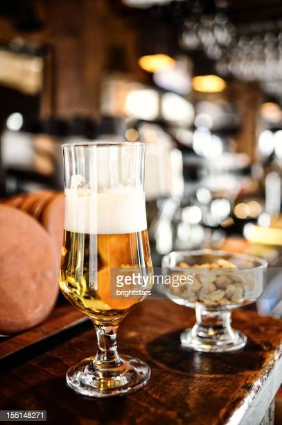 Glass of beer on the bar counter