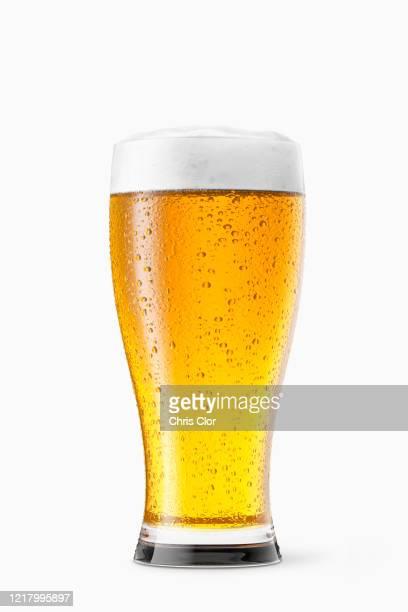 glass of beer on white background - ラガービール ストックフォトと画像