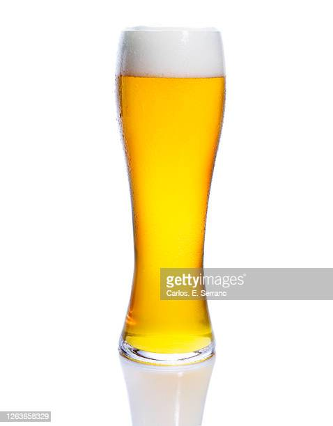 glass of beer with a foam head - ラガービール ストックフォトと画像