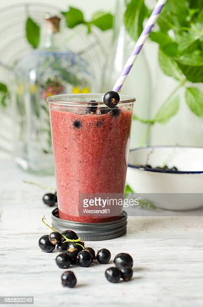 Glass of black currant smoothie
