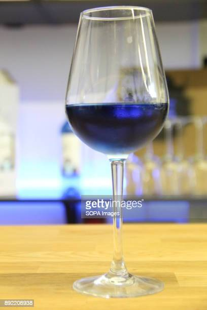 A glass of blue wine pictured in the bar Gik Blue Wine is the first Blue wine in the world is Produced in Bilbao Spain Gik Blue combines red and...