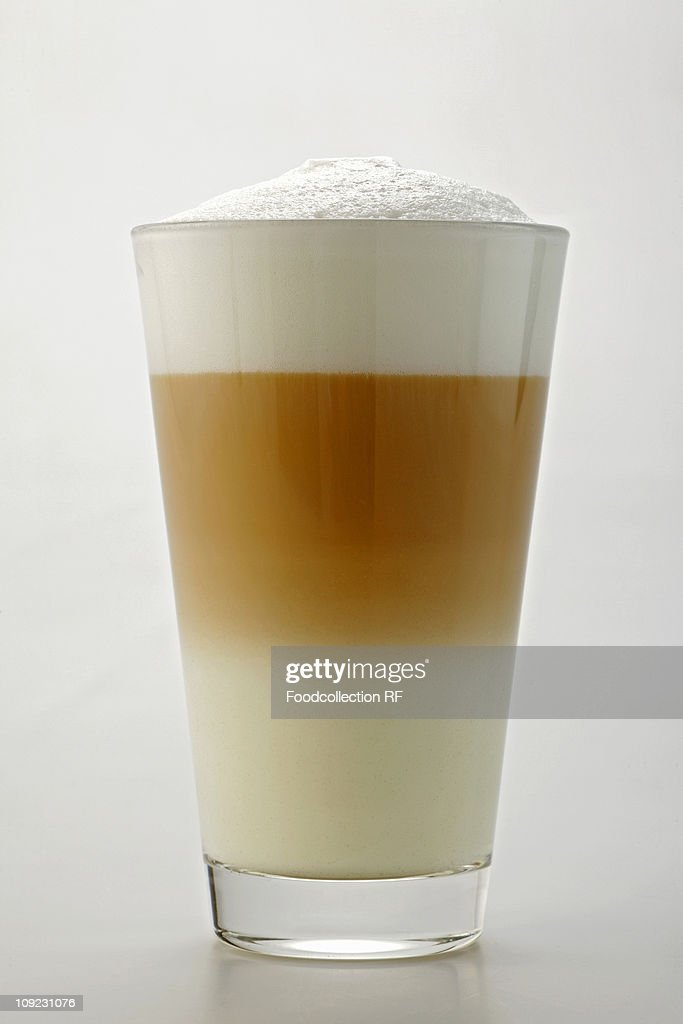Glass of caff latte, close-up : Stock Photo
