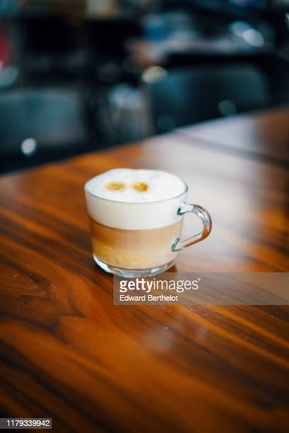 a glass of cappuccino on a wooden table - edward berthelot photos et images de collection