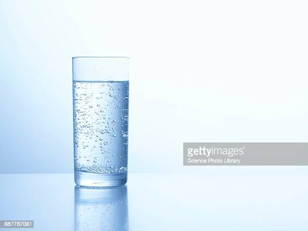 glass of carbonated water - glass of water stock pictures, royalty-free photos & images