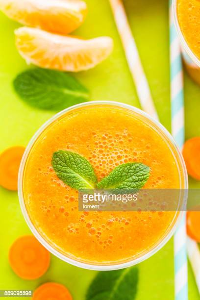 Glass of carrot orange ginger and turmeric smoothie
