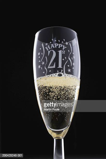 glass of champagne decorated with twenty first birthday motif - 21st birthday stock pictures, royalty-free photos & images