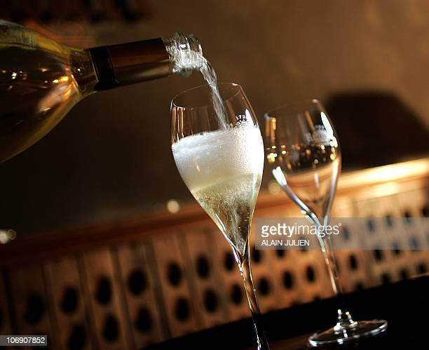 A glass of Champagne is served for a tasting on December 11 2008 at the producer Ruinart's cellars in Reims northeastern France The once sparkling...