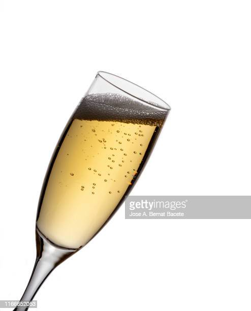 a glass of champagne on a white background. - champagne coloured stock photos and pictures