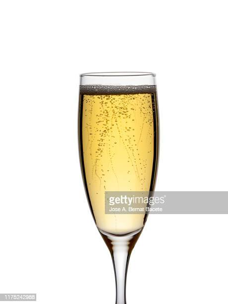 a glass of champagne on a white background. - champagne colored stock pictures, royalty-free photos & images
