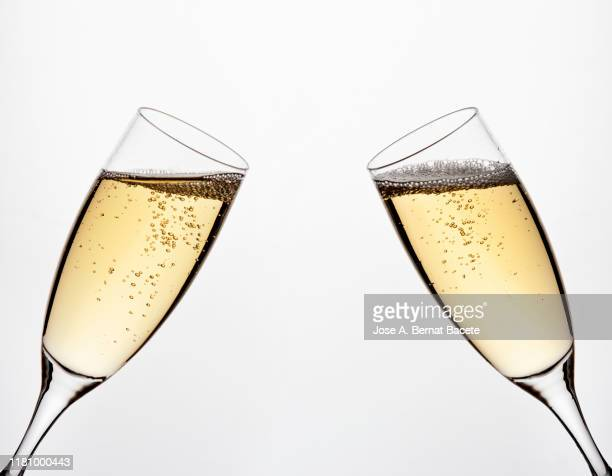 a glass of champagne on a white background. - シャンパン ストックフォトと画像
