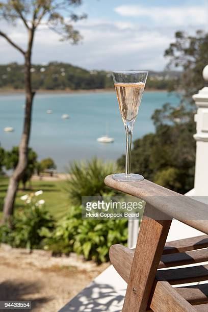 Glass of champagne on arm of chair