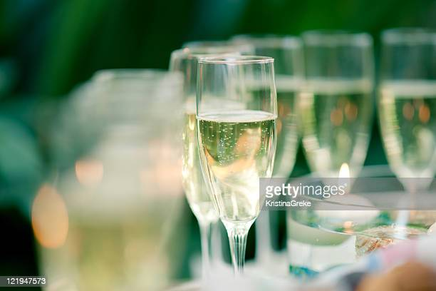 Glass of champagne on the green background