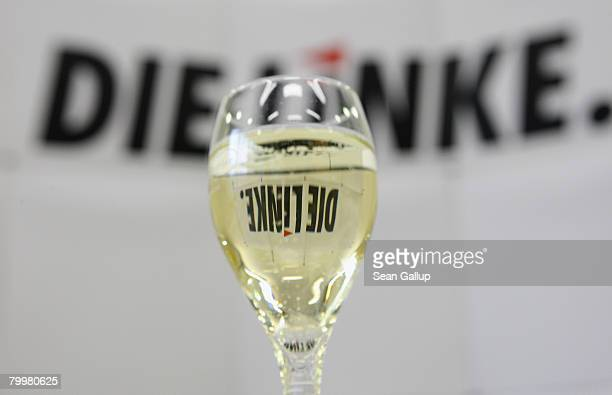 A glass of champagne stands ready at a meeting of the German leftwing party Die Linke leadership the day after Hamburg state parliamentary elections...