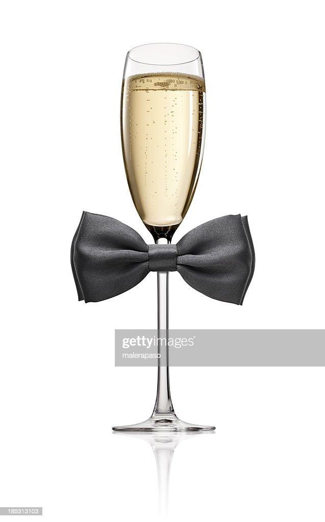 Copa de champán con corbata de moño : Foto de stock