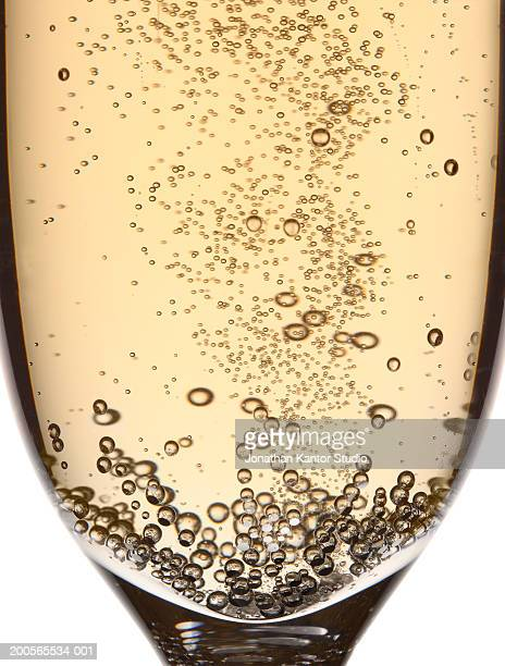 glass of champagne with bubbles, close-up - champagne stock pictures, royalty-free photos & images