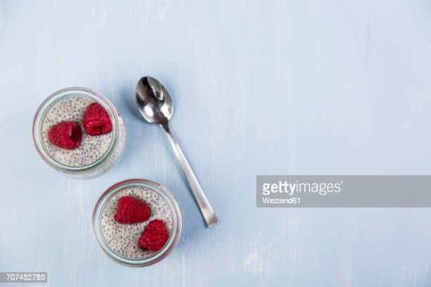 Glass of chia pudding with soya vanilla milk and raspberries